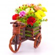 Beautiful and colorful flower bouquet in wooden basket in car sh - Stock Photo