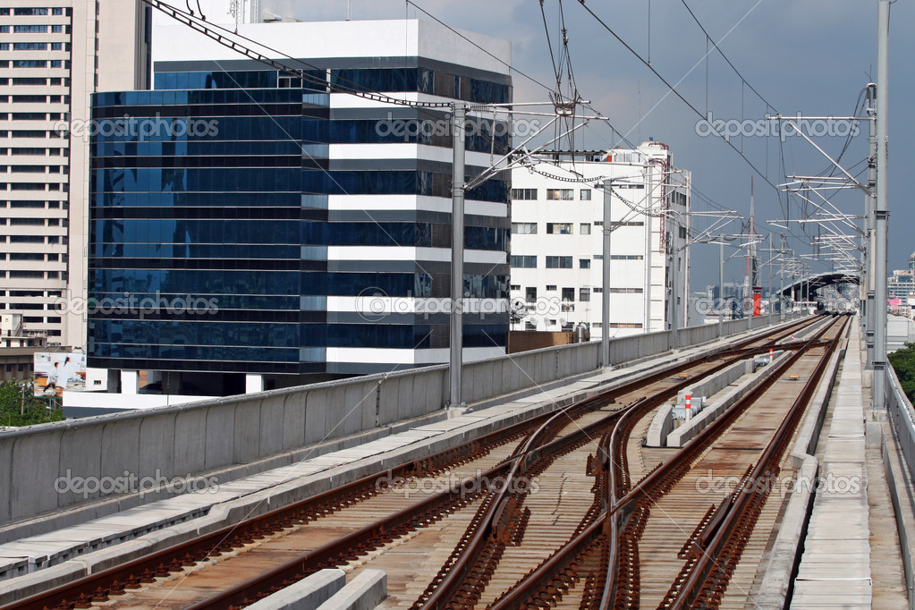 Railway track of sky train in Bangkok Thailand with electric cable line over the track — Stock Photo #11239034