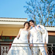 Portrait of lovely bride and groom standing over mediterranean b — Stock Photo