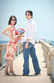Portrait of couples at pier on the beach — Stock Photo