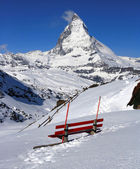 Red chair and Matterhorn, logo of Toblerone chocolate, located i — Stock Photo