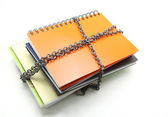 Stack of books with chain — Stock Photo