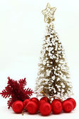 Isolated of Christmas pine tree with red ball ornament and snowf — Stock Photo