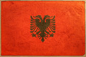 Vlajka albánie na věku papír textury — Stock fotografie