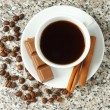 Stock Photo: Cup of coffee with chocolate and cinnamon sticks