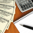 Money, calculator, notepad and pen — Stockfoto
