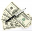 Money and pen with notepad — Stockfoto