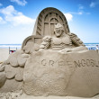 Green goblin sand sculpture - Stock Photo