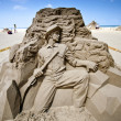Stock Photo: Hunter sand sculpture