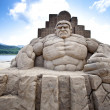 Stock Photo: Hulk sand sculpture