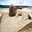 Lizard sand sculpture — Stock Photo #11480515