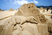 Dinosaurie sand skulptur — Stockfoto