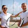 Stock Photo: Womand mon tennis courts