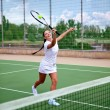 Stock Photo: Young womon tennis court