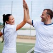 Stock Photo: A woman and a man on the tennis courts
