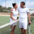 A woman and a man on the tennis courts — Stock Photo #10886970