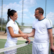 A woman and a man on the  tennis courts — Stock Photo #10886987