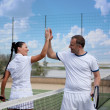 A woman and a man on the tennis courts — Stock Photo #10887013