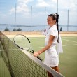 Young woman on a tennis court - Stock Photo