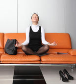Young businesswoman meditating — Stock Photo