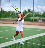 Young woman on a tennis court — Stock Photo