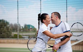 A woman and a man on the tennis courts — Stock Photo