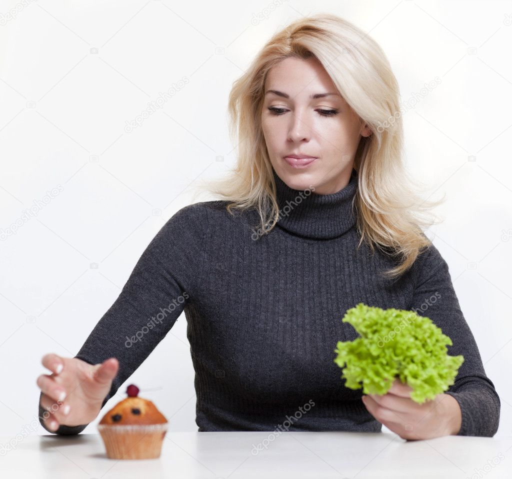 Girl with salad and cake in hands  — Stock Photo #10890320