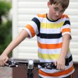 Beautiful boy with a bike — Stock Photo