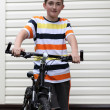 Beautiful boy with a bike — Stock Photo #11235701