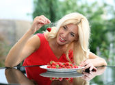 Portrait of a blonde strawberries — Stock Photo