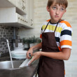 Boy doing the dishes — Stock Photo #11670547