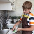 Boy doing the dishes — Stock Photo #11670556