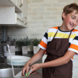 Boy doing the dishes — Stock Photo #11670565