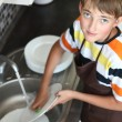 Boy doing the dishes — Stock Photo #11670574