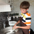 Boy doing the dishes — Stock Photo #11670582
