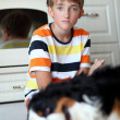 Boy and dog. — Stock Photo #11670611