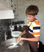 Boy doing the dishes — Stock Photo