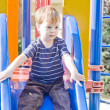Small boy on a slide — Stock Photo
