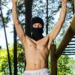 Antiglobalist trains, pull-ups on a bar in a forest — Stock Photo