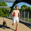 Training before fight. Boxer and dog running outdoors. — Stock fotografie #10917421