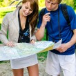 Couple traveling, they look at a map — Stock Photo #10917531