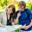 Couple traveling, they look at a map — Stock Photo #10917560