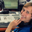 Dj in front of a microphone on the radio — Stock Photo