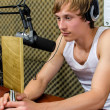 Stock Photo: Sportsmwith prize on radio station