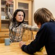 Wife quarrels with her husband in the kitchen — Foto de Stock