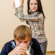 Domestic violence: Wife trying to beat her husband with a plate — Foto de Stock