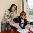 Стоковое фото: Angry businesswoman shouting at her worker