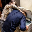 Office revenge: Woman tries to shove the man in the copy machine — 图库照片
