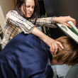 Office revenge: Woman tries to shove the man in the copy machine — Stok fotoğraf