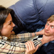 Office fight: Woman trying to stifle a man on the sofa — Stockfoto